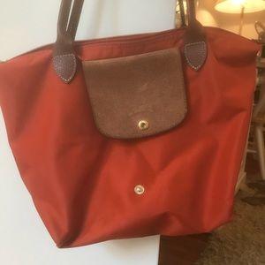 Orange longchamp purse